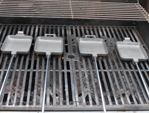 seasoning pie irons on a gas grill